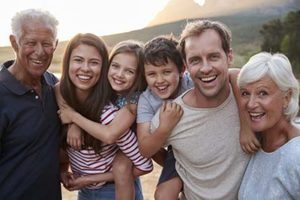 family together smiling because of family dentistry