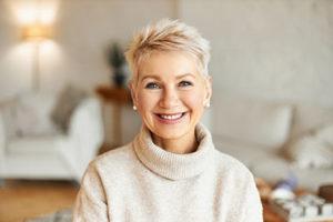 older woman smiling after regenerative dental procedures