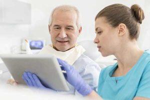 dr. walks patient through his ridge augmentation