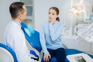 doctor walks patient through her root canal