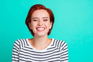 woman smiling after teeth whitening services